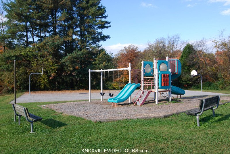 Playground and basketball court behind Village Green clubhouse