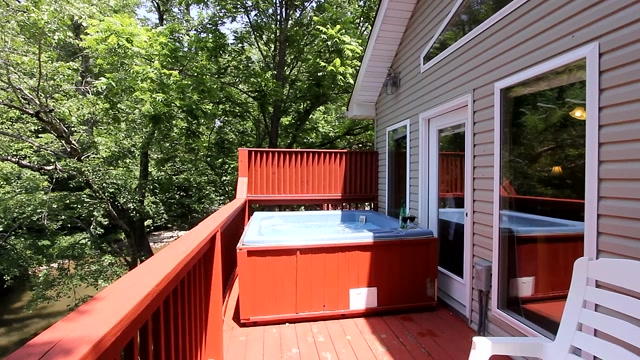 Smoky Mountain waterfront rental home on the Little Pigeon River but just half mile from the Parkway. Come hear the birds and enjoy the rocking chairs and private hot tub. Fish for trout even from your deck. We offer a BBQ Grill, Picnic Table and large covered parking for up to 4 cars.
