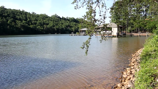 Fantastic Deep Year Round Water Lot in Rarity Bay with double slip dock and rip rapped